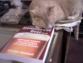 Jake admires George's book - The Complete Homebrew Beer Book